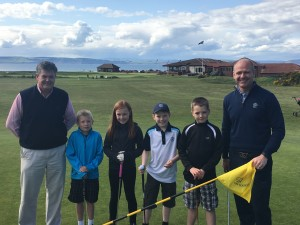 Murray Urquhart (right) with Nairn Golf Club captain Ian Hutcheson and some junior members